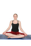 Young woman demonstrating lotus pose Stock Image