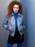 Young woman in a denim jacket Stock Image