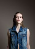 Young woman in denim jeans jacket Stock Photo