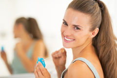 Young woman with dental floss Stock Photo