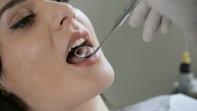Young woman at the dentist stock video