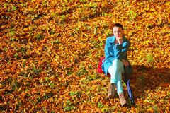 Young woman in depression outdoor autumn park Stock Photography