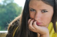 Young woman in depression outdoors royalty free stock photography