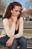 Young woman in depression outdoors Royalty Free Stock Photos