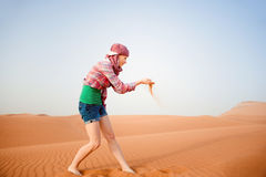 Young woman in the desert. United Arab Emirates Royalty Free Stock Photo