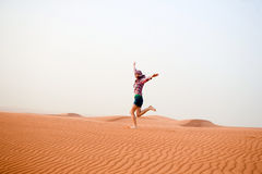 Young woman in the desert. United Arab Emirates Stock Photos