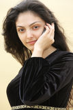 Young woman in desert calling by cellphone closeup Stock Photo