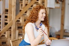 Young woman designer in office Stock Image