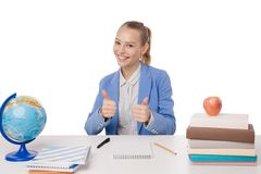 Young woman at the desk gesturing OK Royalty Free Stock Images