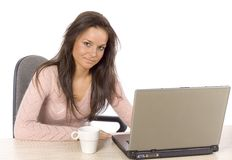 Young woman at the desk with laptop Royalty Free Stock Image