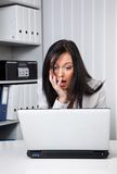 A young woman in a desperate Computerprob. Desperate young woman facing a problem on the laptop Royalty Free Stock Photography