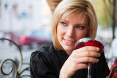 Young woman with a dessert Royalty Free Stock Image