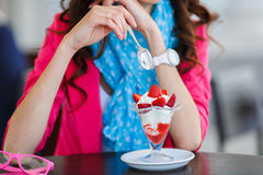 Young woman, dessert ice cream with strawberries Stock Image