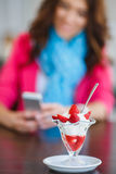 Young woman, dessert ice cream with strawberries Royalty Free Stock Photos