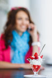 Young woman, dessert ice cream with strawberries Royalty Free Stock Images