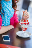 Young woman, dessert ice cream with strawberries Stock Photo