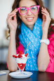 Young woman, dessert ice cream with strawberries Stock Photos