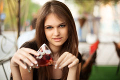 Young woman with dessert at sidewalk cafe Royalty Free Stock Images