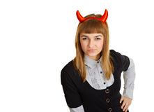 Young woman with devil horns, sly looks Royalty Free Stock Images