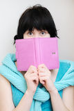 Young woman with diary. Portrait of a surprised young woman with diary Royalty Free Stock Image