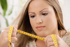 Young woman on diet Royalty Free Stock Photo