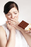 Young woman on diet. Can`t eat chocolate Royalty Free Stock Photos