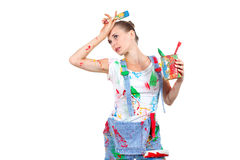 Young woman with different tools Royalty Free Stock Photography