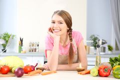 Young woman with different vegetables. At kitchen Royalty Free Stock Photos