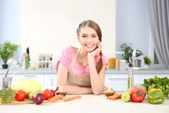 Young woman with different vegetables. At kitchen Stock Images