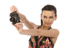 Young woman with digital camera. On the white background Stock Images