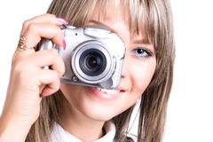 Young woman with digital camera. Isolated on white Stock Images