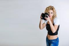 Young woman with digital camera Stock Photos