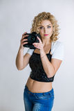 Young woman with digital camera Stock Photo