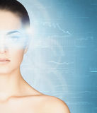 Young woman with a digital hologram on her eye Royalty Free Stock Photos