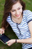 Young woman with digital tablet Stock Images