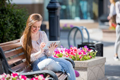 Young woman with digital tablet Royalty Free Stock Photos