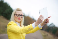 Young woman with digital tablet Royalty Free Stock Images