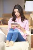 Young woman with digital tablet Royalty Free Stock Photo