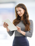Young woman with digital tablet Royalty Free Stock Image