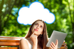 Young woman with digital tablet in the park Stock Photography