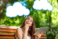Young woman with digital tablet in the park Royalty Free Stock Image