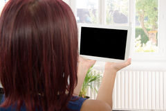Young woman with a digital tablet. A pretty young woman with a digital tablet Stock Images