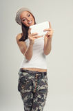 Young woman and digital tablet Royalty Free Stock Photography