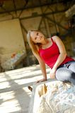 Young woman in dilapidated warehouse Stock Image