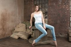 Young woman in dilapidated warehouse Royalty Free Stock Photos