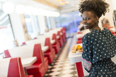 Young woman in the diner Royalty Free Stock Photo