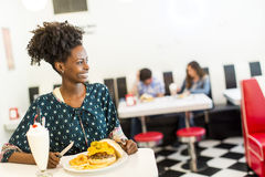 Young woman in the diner Stock Photography
