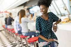 Young woman in the diner Stock Images