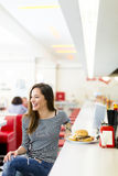 Young woman in the diner Stock Image