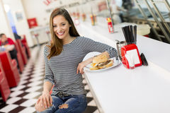 Young woman in the diner Royalty Free Stock Images